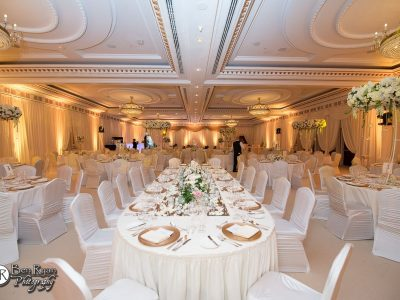 Full Room Design with Draping, Uplighting, Large Floral Centrepieces, Floral Design and Linens for a Wedding Reception