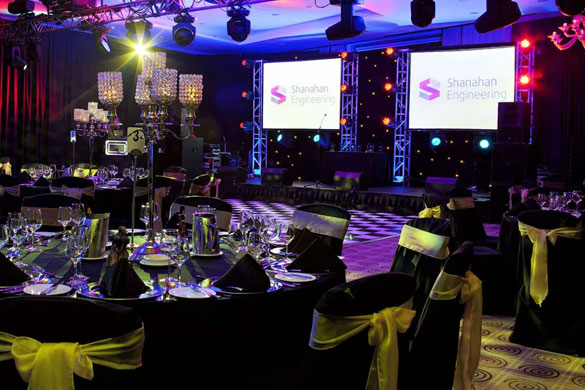A corporate event design with full room draping, a black and white dance floor, centrepieces and linens at the Royal Marine Hotel by Event Central