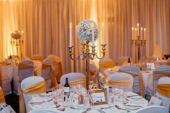 A Baby's Breath centrepiece, with full room draping and uplighting for a Wedding Reception in Tulfarris Hotel
